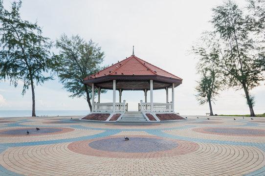 Thai pavilion on the colorful cement block near sea
