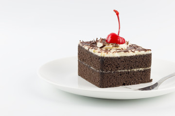Chocolate cake with cherries on white background
