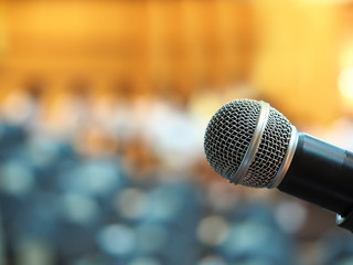 microphone in meeting room or conference room with blurred light background