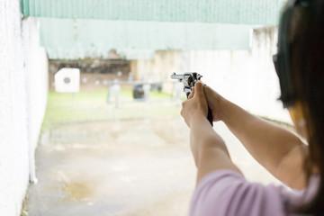 women shooting target