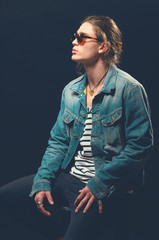 Rock and roll man. Guy in a rocker clothes. Rock style. Casual style. Toned image.