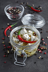 Feta cheese marinated in olive oil with spices