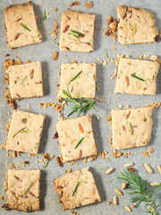 Cookies with rosemary and pine nuts. Vertical image