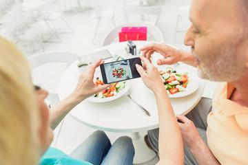 Mature husband and wife using modern technology