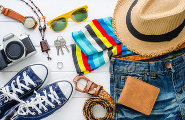 Travel accessories and costume on white background