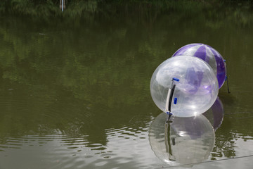 inflatable transparent ball in pond
