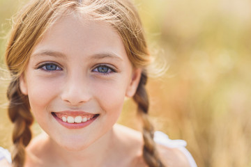 Innocent female child expressing positive emotions