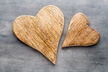 Two vintage hearts on gray metal background.