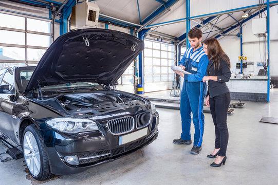 Car mechanic and customer
