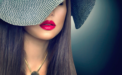Wall Mural - Beautiful sexy brunette woman with red lips in modern black hat