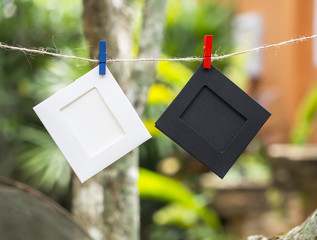 Photo Frames on Rope. background the nature, soft focus.