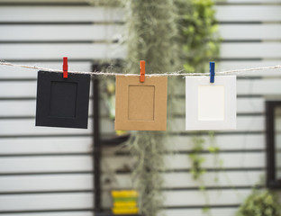 Photo Frames on Rope. background the nature, soft focus