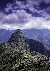 Vertical picture of the lost Inca city of Machu Picchu ruins.