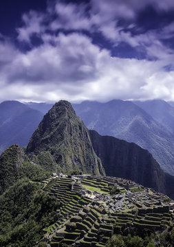 Vertical picture of the lost Inca city of Machu Picchu ruins.