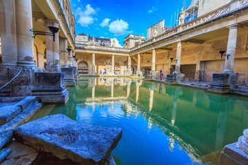 BATH, ENGLAND - JULY 8, 2014: inside of Roman Baths with unidentified people, which is a site of historical interest in the city of Bath. The house is a well-preserved Roman site for public bathing.