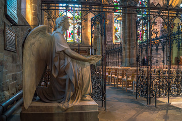 the marble statue of an angel in a church