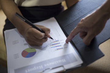 Image of male hand pointing at business document during  busines