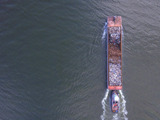Aerial image of a garbage barge in the river