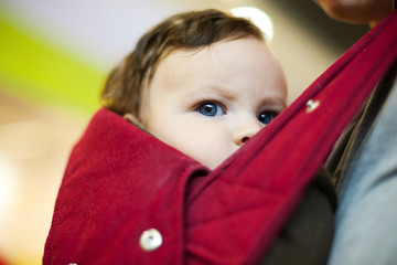 Child carried in sling