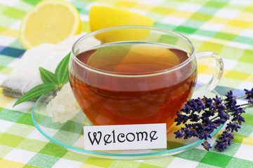 Welcome card with cup of lemon tea and lemon