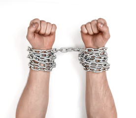 Close up view of chained man's hands