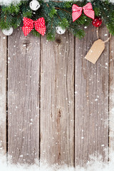 Christmas background with fir tree and bow decor