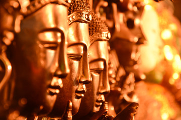 Gold Buddha head arranged selective focus.