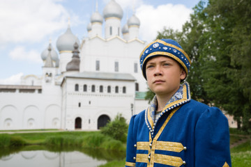 Boy in national russian suit  in Kremlin Rostov Great