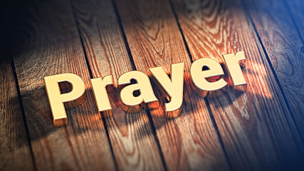 Word Prayer on wood planks