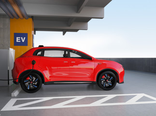 Red electric SUV recharging in parking garage. 3D rendering image. original design.