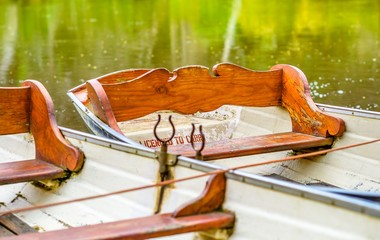 Small wooden row boats for hire at Fairfield Boathouse in Victoria Australia