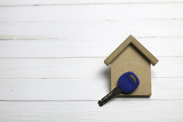 appartment key on wooden background