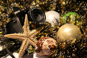 Christmas and new year's tinsel and a camera