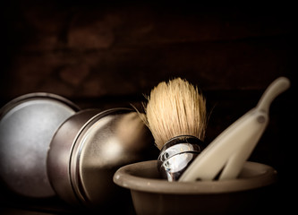 barber shop accessories with razor and soap brush