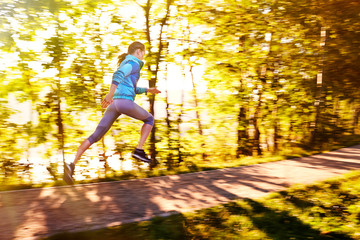 Young woman running fast during morning workout