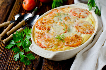 Casserole with rice, sea bass, tomato and cheese