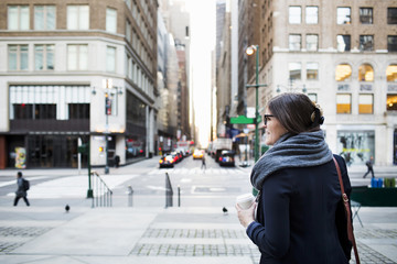 Woman standing on sidewalk in New York City