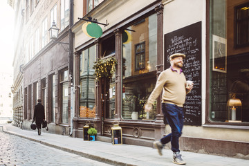 Sweden, Stockholm, Gamla Stan, Man walking by cafe