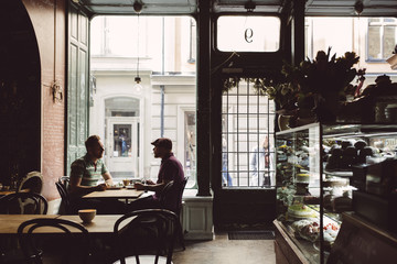 Two men sitting in old fashioned cafe