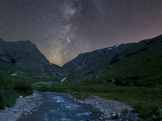 Night river and mountain landscape with milky way