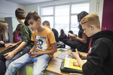 Schoolchildren (12-13, 14-15) in classroom