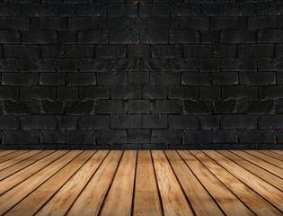 Empty wooden plank floor and black brick wall,Room interior back