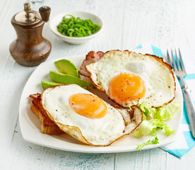fried eggs on white plate