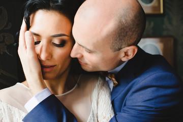 Portrait of beautiful luxury newlyweds