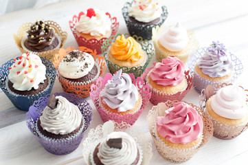 Many different colored delicious cupcakes