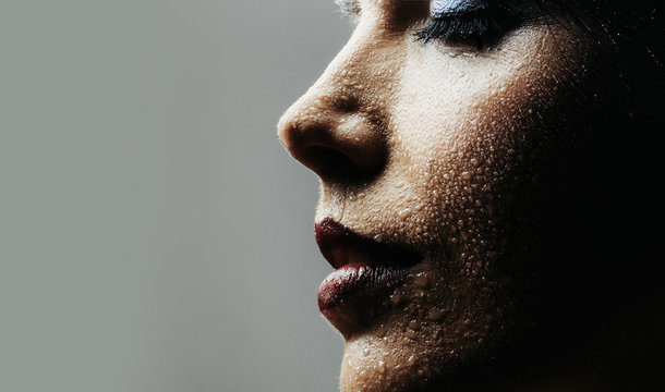 Woman with water on face