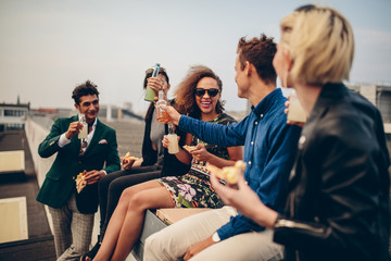 Group of young adults drinking outdoors Wall mural