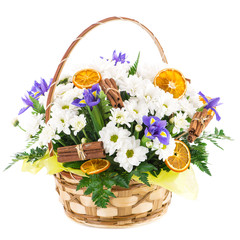 basket with fresh flower, cinnamon and orange, gift, isolated on