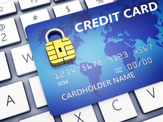 Credit card with security chip as padlock on a computer keyboard , Safe banking and online shopping