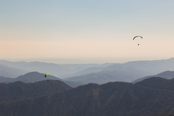 Wall Murals Sky sports Paragliders flying over mountains